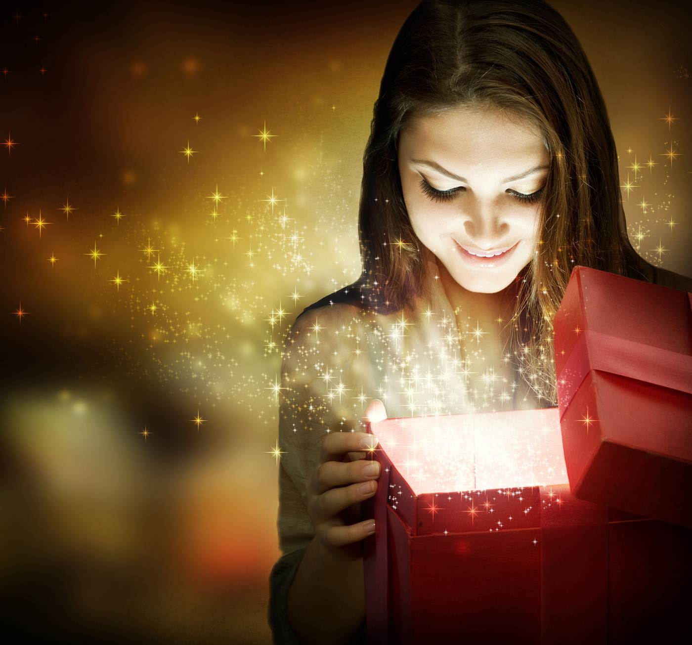 Woman opening a gift with excitement